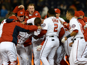 LaRoche being clobbered by teammates after hitting a game winning single. (C/O Patrick Smith, Getty)